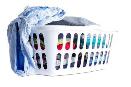 basket: Close up Folded Clean Clothes Piled in Two in a White Plastic Basket, Isolated on White Background.