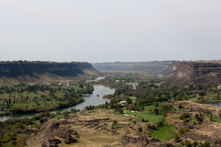 river banks: Scenic landscape view of the Snake River Canyon near Twin Falls, Idaho showing farms established through irrigation on the river banks in the valley running through the gorge