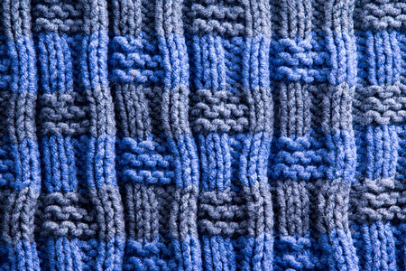 Close up Homemade Woven Crochet in Blue and Gray with Vertical Orientation of Ridge Lines. Can be Used for Wallpaper Backgrounds. photo
