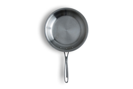 Close up One Clean Steel Kitchen Frying Pan Isolated on a White Background with Copy Space.