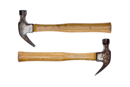 Two old rusty claw hammers arranged facing in opposite directions conceptual of equal power isolated on a white background Stockfoto
