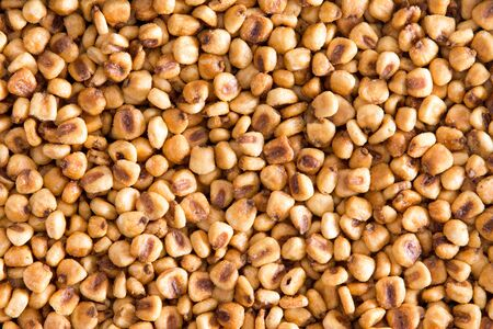 mealie: High Angle Full Frame View of Toasted Salted Corn Nuts Snack Ideal for Backgrounds