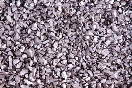 irregular shapes: La textura de peque�as piedras de plata con un brillo met�lico en formas irregulares y patr�n aleatorio, detalle overhead primer