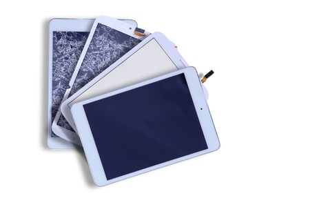 repaired: Fanned arrangement of four tablets with blank screens showing two with smashed broken glass and two with repaired screens in the corner on white with copyspace Stock Photo