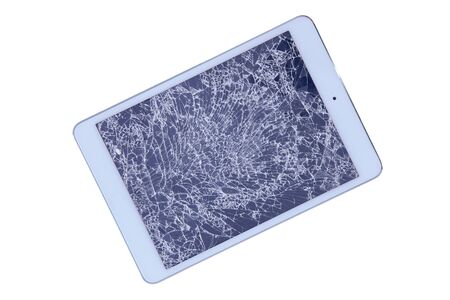 replaceable: Tablet with a shattered glass screen rendered unusable after an accident or fall viewed isolated on white from above, diagonal with copyspace