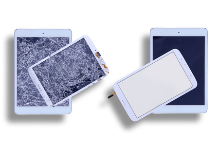 Overhead view of two tablets with shattered glass screens alongside two with repaired tablet screens in a comparative image on a white