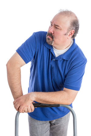 vindictive: Serious Adult Man in Blue Shirt Leaning Against the Chair While Looking to the Left. Isolated on White. Stock Photo