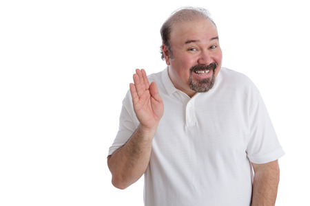 funny bearded man: Hello there from a big guy concept with an overweight middle-aged balding man with a goatee beard leaning forwards with a cheerful smile waving his hand in greeting, isolated on white Stock Photo