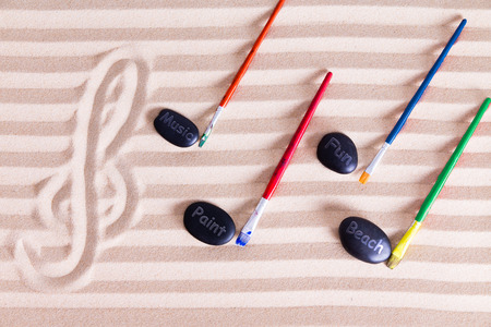 g: Music, Paint and Fun at the Beach for Resort Activities, G clef at the left music notes made out of colorful paint brushes and black rocks writing music, paint, fun, and beach