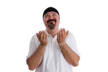 supplication: Middle-aged casual man with a goatee imploring God to find a solution raising his hands in supplication and looking up to heaven with a beseeching expression, isolated on white Stock Photo