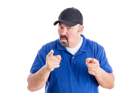 bigoted: Dogmatic man making a point in a discussion pointing a finger with an intense expression as he seeks to get his way, isolated on white Stock Photo