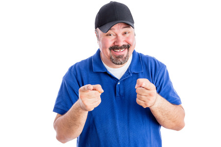 gleeful: Gleeful happy middle aged man in casual clothes pointing at the camera with a playful amused expression, isolated on white