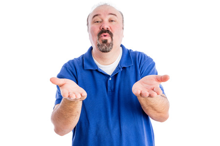 Persuasive middle-aged man with a goatee cajoling and pleading with his hands outstretched , upper body in a blue t-shirt isolated on white