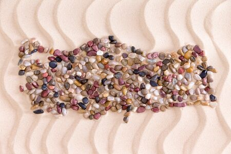 quartzite: Travel concept with a creative Turkish map formed of colorful water worn agate and quartzite pebbles on decorative golden beach sand with a rippling wavy pattern Stock Photo