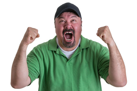 venting: Excited Overweight Man Wearing Green Shirt and Black Baseball Cap Celebrating, Pumping Fists and Cheering in Studio with White Background Stock Photo