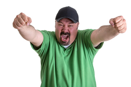 verbal: Happy Portrait of a Bearded Adult Man, in Casual Green Shirt with Cap, Screaming Out While Raising his Arms After his Team Wins. Isolated on White Stock Photo