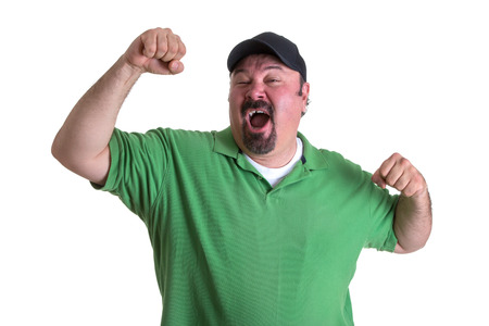 winning mood: Winning Adult Man Raising his Arm for Victory, Emphasizing Feeling So Good Expression. Isolated on White Background. Stock Photo