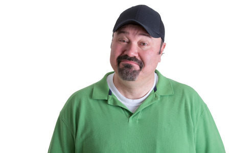 wistful: Portrait of a Bearded Adult Man in Green Shirt with Cap Got Emotional Face While Looking at the Camera. Isolated on White Background.