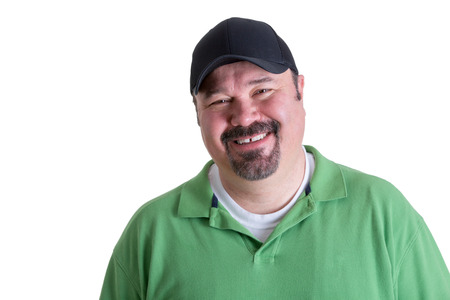 sincere: Portrait of Overweight Man Wearing Green Shirt and Black Baseball Cap Smiling in front of White Background, Head and Shoulders Portrait of Joyful Man