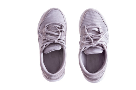 pliable: High Angle View of Pair of Worn White Sneakers or Running Shoes with Tied Laces on White Background