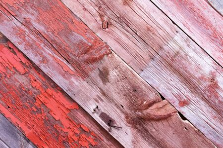 gouged: Authentic weathered battered diagonal wood planks with rusty nails, stains and remnants of paint from a demolished building Stock Photo