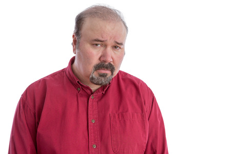 abject: Upset and disappointed bald frowning middle-aged man looking at camera with a depressed facial expression, isolated portrait on white