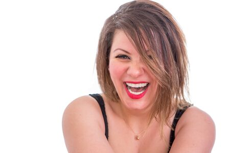 mirth: Close up Portrait of a Happy Blond Woman Laughing at the Camera, Isolated on White .