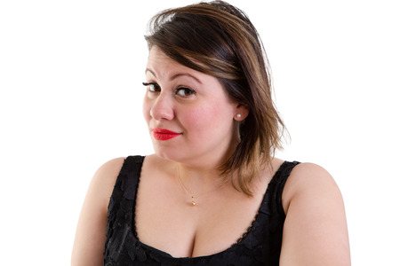 quizzical: Sceptical woman with raised eyebrows looking sideways at the camera with a quizzical expression showing her incredulity and distrust, isolated on white