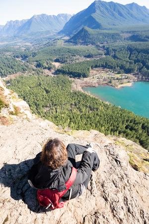 rewarding: Woman enjoying rewarding view of  Seattle Washington Rattlesnake Ledge Trail after 40 minute trekking