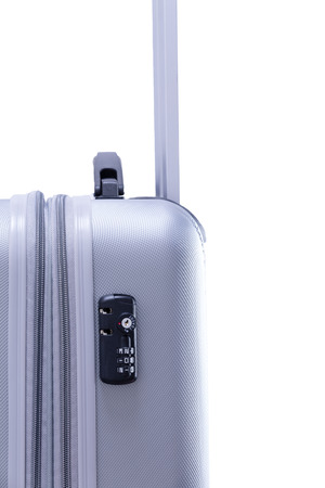 theft prevention: TSA travel lock on a suitcase, approved by the Department of Homeland Security, America as it allows their agents access to the contents for a security check via means of a key , on white