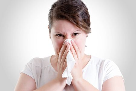 haemorrhage: Middle age lady blowing her nose too hard, blowing your nose too hard can give you damage
