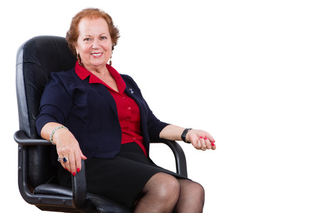 Cheerful Senior Businesswoman Sitting on her Chair And Smiling at the Camera Against White Background.