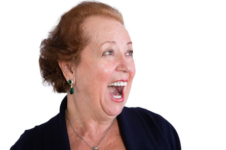 Close up Senior Woman Showing a Surprised Facial Expression with Mouth Open and Looking to the Right of the Frame, Isolated on White Background.