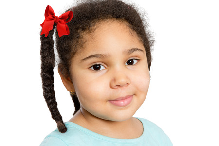 Close up Cute Young Girl with Braided Curly Hair Looking at You with Half Smile, Isolated on White Background.
