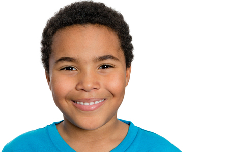 child portrait: Close up Young Turkish African Boy Looking at the Camera with Happy Facial Expression Against White Background. Stock Photo