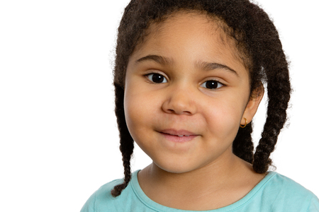charming girl: Close up Charming Four Year Old Girl with Braided Curly Hair Smiling at You Against White Background. Stock Photo