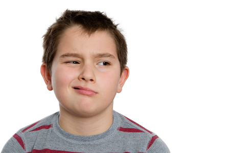 disinterested: Close up Ten Year Old Boy Looking to the Right with Bored Facial Expression, Isolated on White Background.