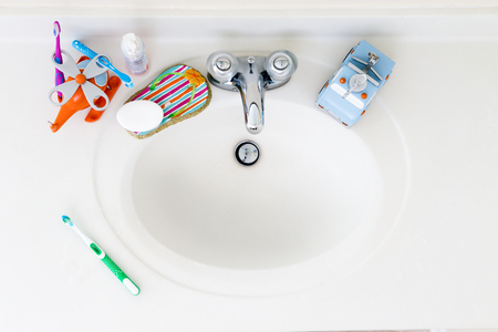 Kids Domestic Bathroom Sink with toothbrushes and hand soap