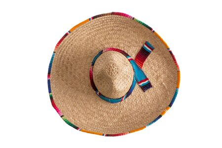 mexican background: Surprise - what is hidden under the wide brim of the traditional sombrero hat, symbolic of Mexico, travel and tourism, overhead view isolated on white