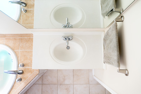 Overhead View of Classical Acrylic Top Sink along with a full bathtub and faucets