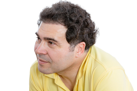 preoccupied: Close up Curly Middle-Aged Man Listening to Something Carefully While Looking to the Left of the Frame, Isolated on White Background.