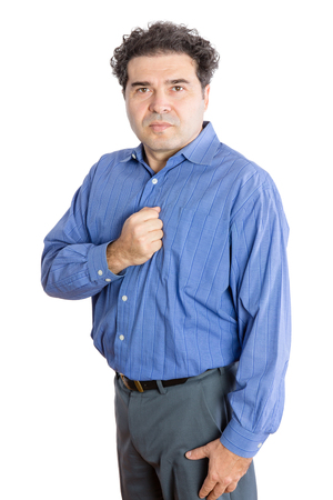 earnest: Three Quarter Shot of a Middle-Aged Businessman Putting his Fist on his Chest and Looking at the Camera. Isolated on a White Background. Stock Photo