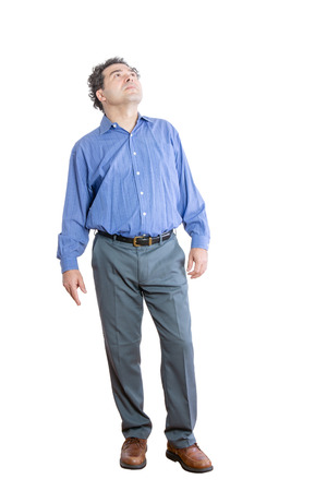 Full Length Shot of a Pensive Middle-Aged Office Man Looking Up High Against White Background. 写真素材