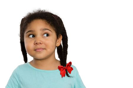 sideways glance: Close up Curious Four-Year Old African American Girl Looking to the Side Against White Background. Stock Photo