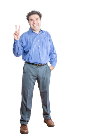 exultant: Full Length Shot of a Happy Businessman Showing a Peace Hand Sign at the Camera. Isolated on a White Background.