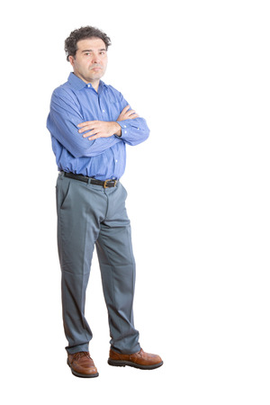upset: Full Length Shot of an Upset Businessman Looking at the Camera with Arms Crossing Over his Chest. Isolated on a White Background.