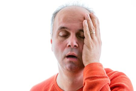 guilt: Man asking himself what I have done, deplored for his actions holding his side of head with guilt Stock Photo