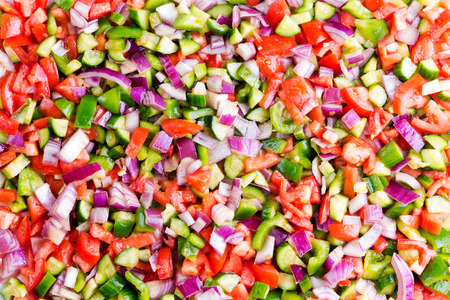 Food background of healthy Turkish shepherd salad in a full frame view of colourful mixed diced fresh vegetables viewed close up from overhead