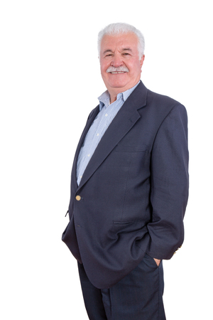 portly: Single handsome grinning senior adult male with mustache and blue blazer with hands in pockets