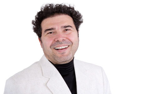 high spirited: Single handsome laughing adult man with black hair and white jacket over black shirt laughing